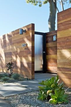 front curb appeal: fencing, lights, hardware, door