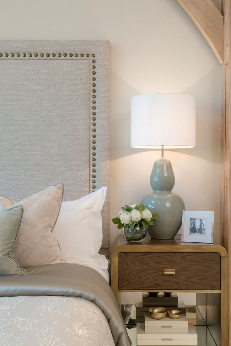 This bedside table by Julian Chichester adds an antique, vintage look to this design; the brass clad edges and oak finish create a traditional visage, contrasting with the neutral tones in the surrounding fabrics.