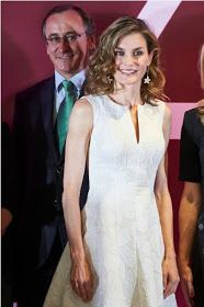 Spanish Queen Letizia looked chic in ivory today as she donned a white Carolina Herrera dress to attend the Fedepe awards, which celebr...