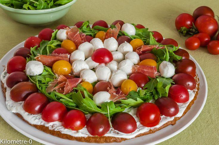 Tarte+salée+aux+tomates+cerises,+mozzarella+et+roquette