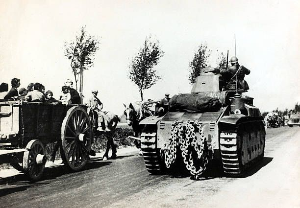 22nd May 1940, A French tank on it's way to the battle front passing a line of farmcarts carrying refugees to safety, Germany's victory in France in 1940 followed the 'Phoney War, (September 1939-April 1940) and the German breakthrough accomplished at great speed meant France was forced to surrender in June 1940 - pin by Paolo Marzioli