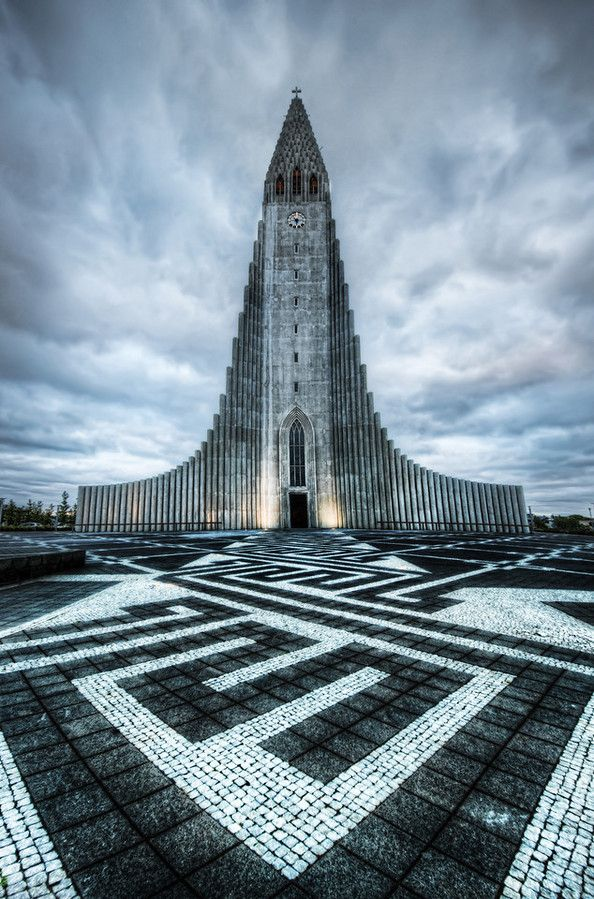 Isn't this a beautiful and unique church? It's been so long since I've posted a photo of it. It's called Hallgrimskirkja. This is much easier to say if you are a dolphin. And drunk. - Reykjavik, Iceland - Photo from #treyratcliff Trey Ratcliff at http://www.stuckincustoms.com/