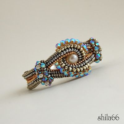 Beaded by Csilla Csirmaz: one of the most gorgeous beaded rings I have ever seen.. oh wait; it's a bracelet *sigh* still pretty though