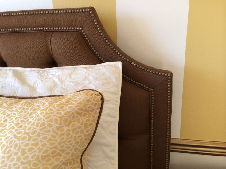 Warm golds and rich coppery accents add a glow to the guest room.