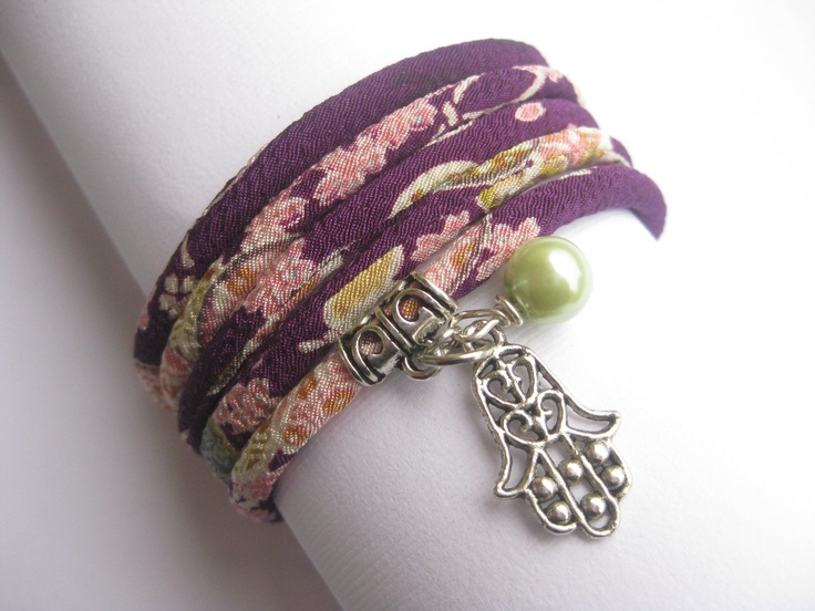 Wrap Cord bracelet lucky Hamsa hand of Fatima charm Judaica jewelry Wrap Japanese cord bracelet Unique gift for her under 50. $25.99, via Etsy.