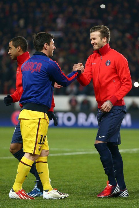 Soccer - David Beckham shakes hands with Lionel Messi