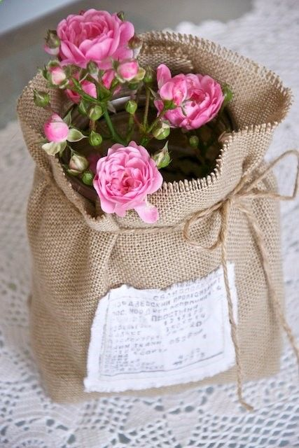 I have potted mini roses that need to stay outside to grow well, but I like to bring them in for a visit too ... having a burlap sack like this to dress up their pots, easy on-easy off, would be great - and roses   burlap =  what a great idea! Can put that little ragged edge patch on it with a muted transfer of a rose, or have rose in fancy script on in fancy script with swirls on it - love the inspiration!