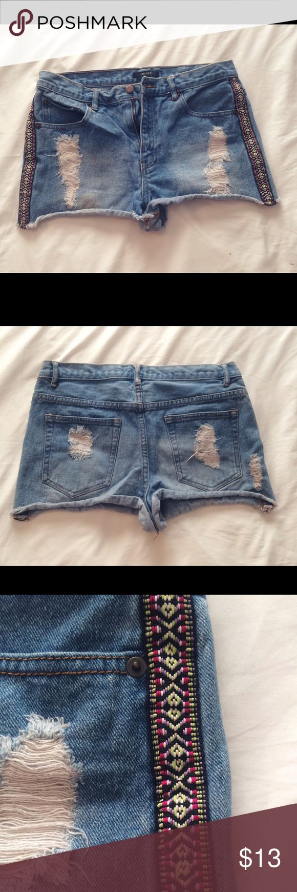 High Waisted Jean Shorts - Forever 21 These are the perfect staple high waisted shorts for your wardrobe, they definitely were for me! They're well loved, but I personally think that makes jean shorts look even better. They're certainly not in bad condition either, just not brand new. The tribal side panel on them gives just enough spark to this pair to spice things up while still keeping it classic. Forever 21 Shorts Jean Shorts