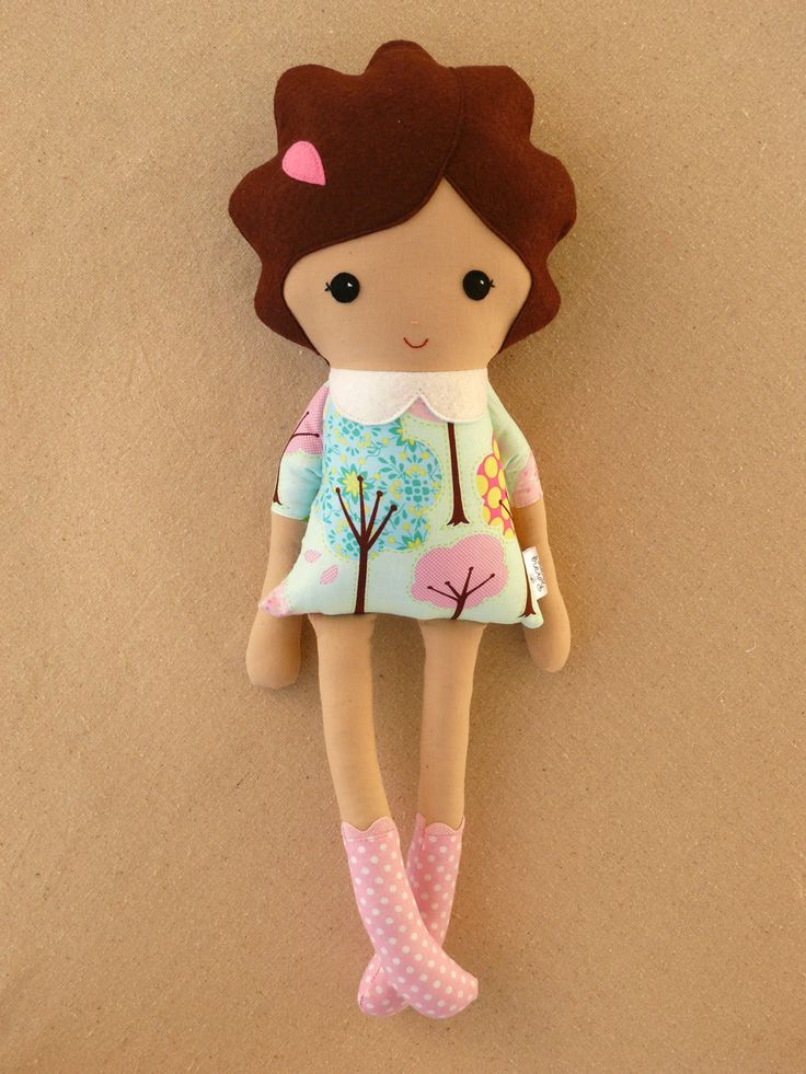 Etsy vendor Roving Ovine makes adorable rag dolls. This especially cute doll option ($35) is wearing a mod tree-print dress with a white felt collar as well as pink-and-white polka-dotted boots. A pink barrette is in her brown curly hair.