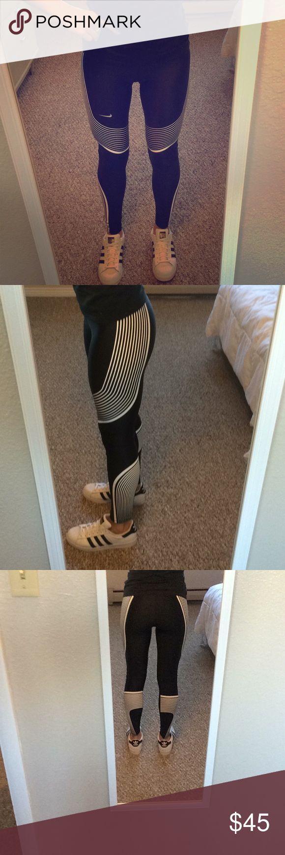 Nike black and white running tights Nike black and white running tights. Worn once. Dri-fit technology. Back zip pocket. Beautiful. Nike Pants