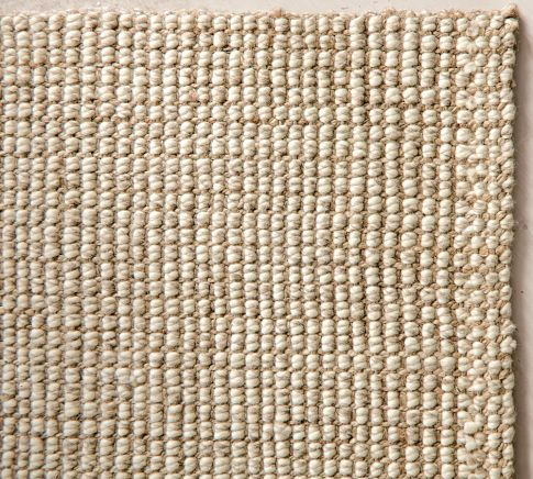 This chunky wool & jute rug will bring a great texture to the living room if used over a wood floor.