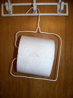 Toilet Paper Holder made with a wire hanger...costs $0 to make! You might be a red neck if you made one of these