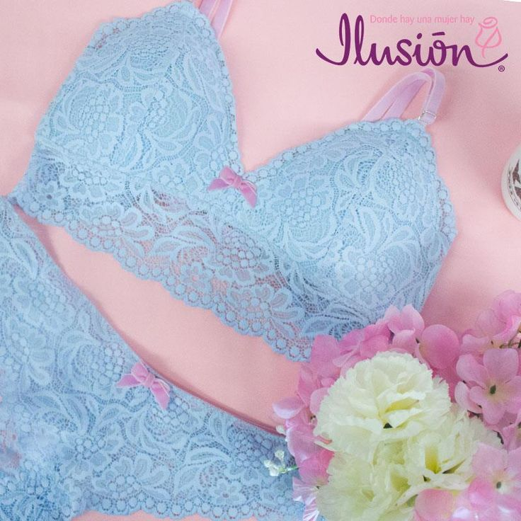Lace bralette with corset style length. Triangle shape with soft cups for light support. Feminine bow detail at bust This bra goes great alone or as a set with panty 1951. Available in Serenity and Indigo. For more lingerie visit Ilusion.com