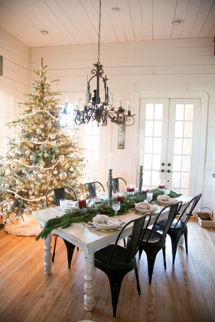 """Beautiful way to do a holiday table, with several vases of cranberries and floating candles, a fresh green """"runner"""" and a couple of tall candle sticks."""