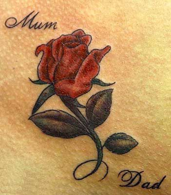 Red rose tattoo with the words Mum and Dad- no mom n dad add another rose and our names?