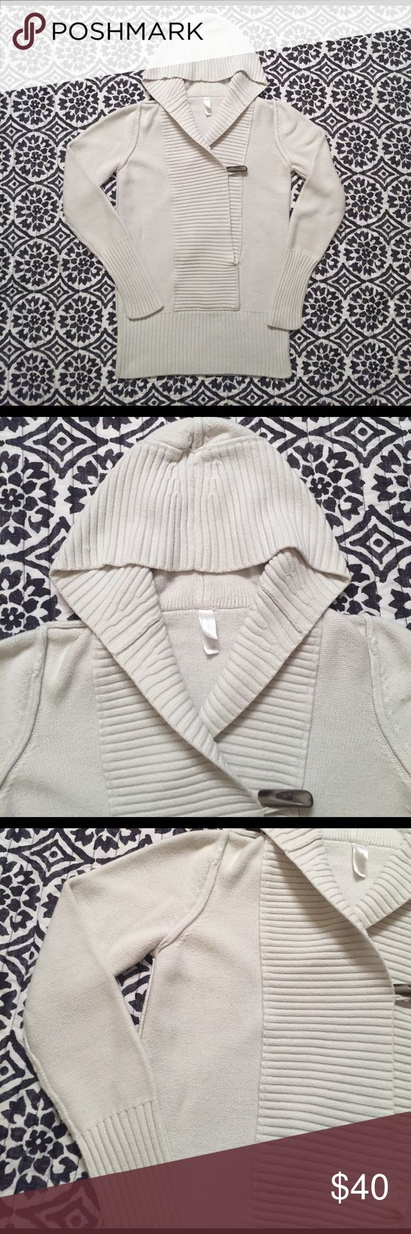 GAP Body sweater with toggle detail Great sweater I always got lots of complements on it and people asking where I got it from. A few mild pills here and there but not noticeable. Off white or ivory.  ❌ no trades ❌ no holds ❌ no lowballs  ✅ if it's listed it's available ⬆️ above will be ignored🙅🏻 GAP Sweaters V-Necks