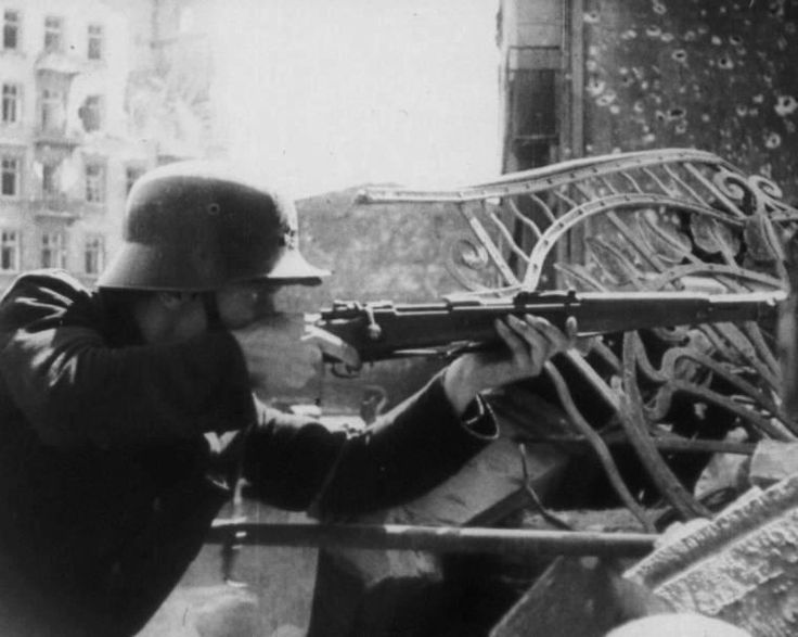 Insurgent during the fighting in the Srebrna street