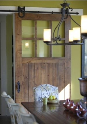 Sliding Barn Door, and the gorgeous green wall color makes a great combo!