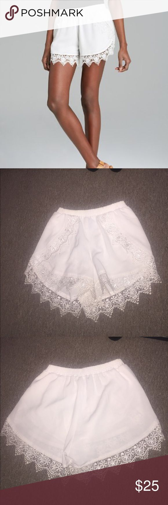 Aqua Lace trim shorts from Bloomingdales White lace trimmed stretch  shorts.  The inside is lined to avoid see through white bottoms. Aqua Shorts