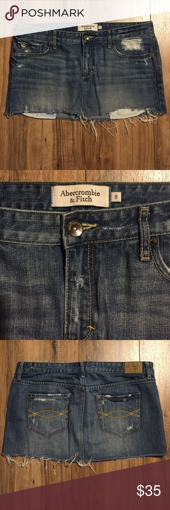 Abercrombie and Fitch denim skirt Very vintage skirt. Purchased it more than a decade ago, but still holds up well and is very fun and flirty. Pockets hand out the front at the bottom to give it and edgy distressed look Abercrombie & Fitch Skirts Mini