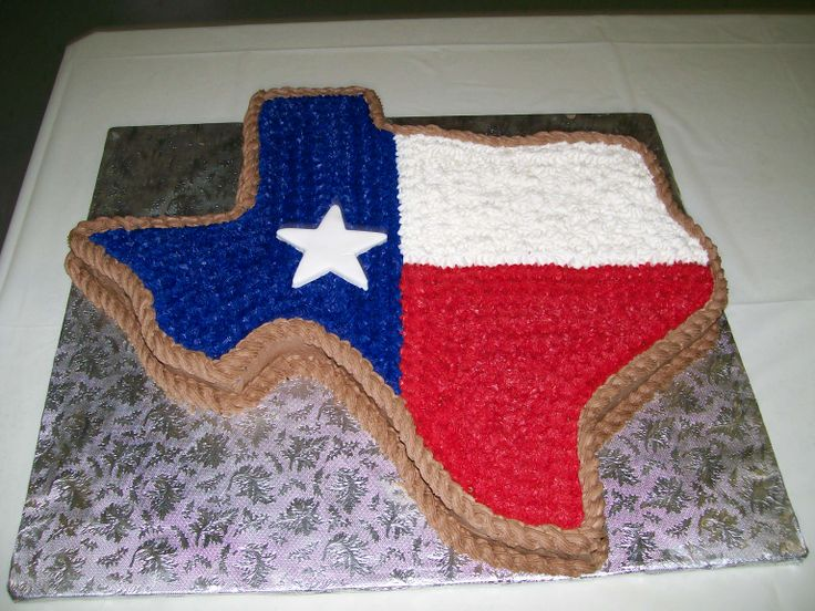 State of Texas - Deep chocolate cake with deep chocolate buttercream frosting and vanilla frosting piped on the top in the colors. The star is vanilla fondant.