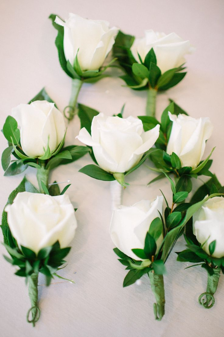 White rose boutonnieres | Read More: http://www.stylemepretty.com/little-black-book-blog/2014/06/13/modern-escondido-art-center-wedding/ | Photography: Aga Jones Photography - agajonesphotography.com/