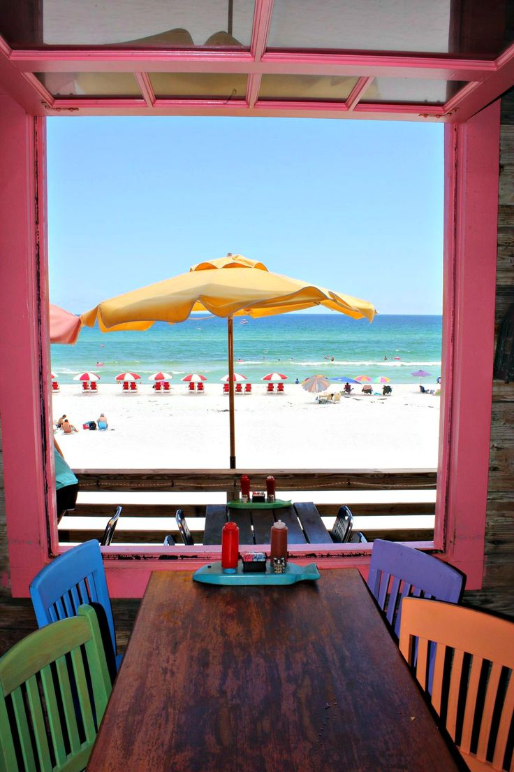 Table with a view at Pompano Joe's, www.beachguide.com/Destin/Restaurants/PompanoJoes