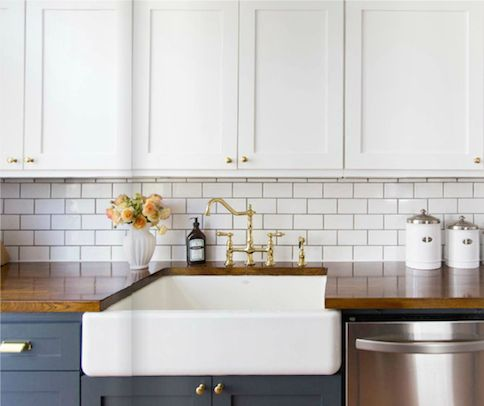 Blue cabinets, farm sink and gold... beautiful kitchen!!