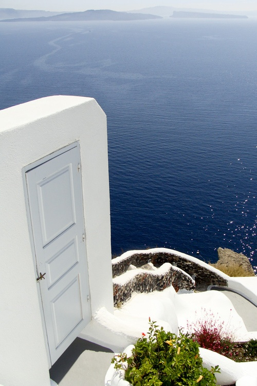 Santorini, Greece. Visited in 2005 and this is truly the most beautiful place I've ever been to.  I firmly believe Atlantis is underneath Santorini.