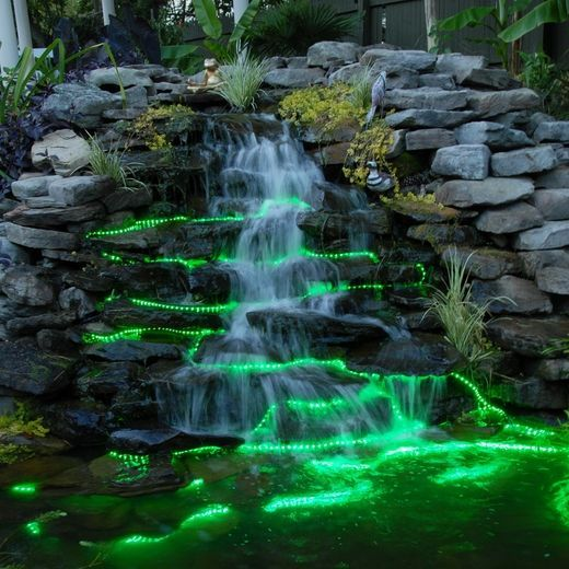 Fully submergible color-changing tape lights can dramatically enhance an outdoor water feature!