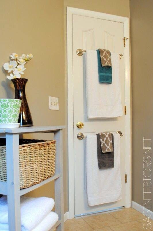 I like the towel racks on the back of the door. Out of sight . . .