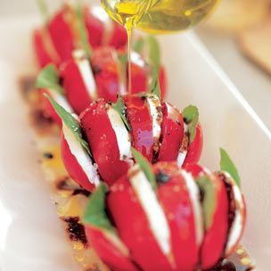 Tomatoes filled with mozzarella slices and basil leaves make for a beautiful presentation and are easy to serve.
