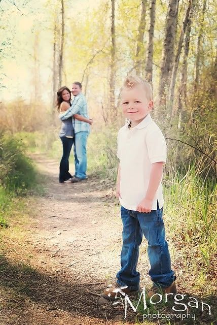 I love how the kid is in front, so he feels like more of the focus is on him, while the parents get to be all cuddly in the background :)