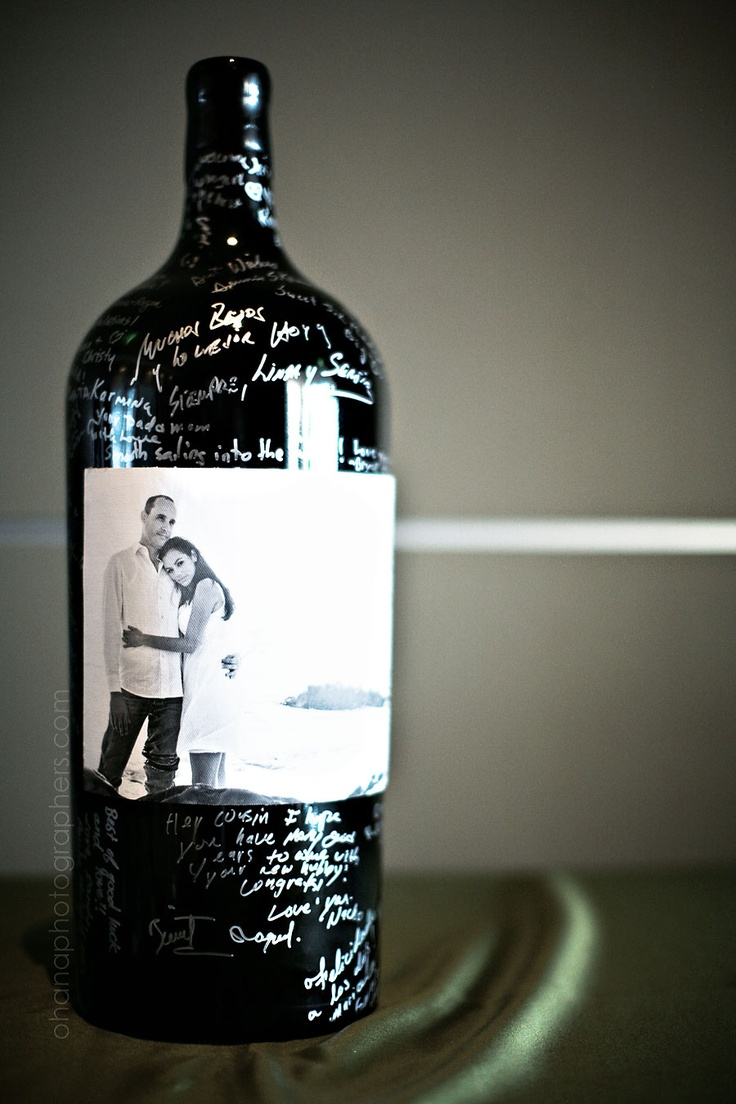 Big wine bottle can be used in place of a sign-in book and opened at a future anniversary party!