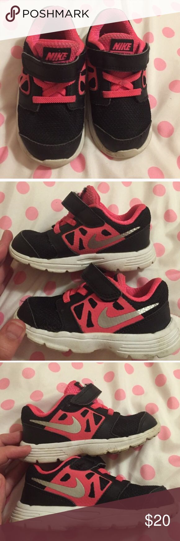 Nike free runner Adorable black n pink wit silver check logo. Good condition n very lite on the toddlers feet. 7C Nike Shoes Sneakers