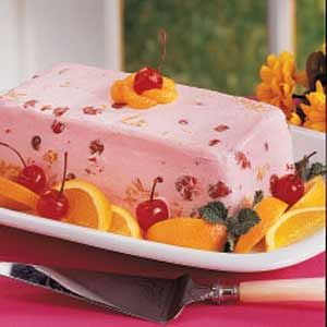 Ingredients  1 package (8 ounces) cream cheese, softened  1 carton (8 ounces) frozen whipped topping, thawed  1 can (21 ounces) cherry pie filling  2 cans (11 ounces each) mandarin oranges, drained  Maraschino cherries and orange wedges, optional