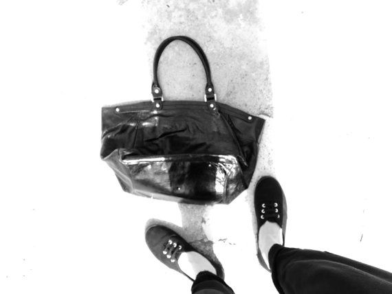 Beautiful Nannini bag, Florence-based Italian designer with a passion for visual pleasure and the beauty of lines. With its black shiny leather, the bag is great for work and life. It will carry all you need and do it stylishly.  Rarely used item in great shape: no visible defects, scratches, marks or stains.