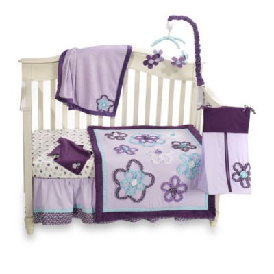 NoJo® Harmony Collection - BedBathandBeyond.comThis adorable purple crib bedding set features flowers in a light blue and purple. The 8-piece crib bedding set includes a comforter, dust ruffle, floral print sheet, solid sheet, valance, diaper stacker, sheet saver and security blanket.