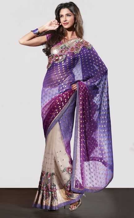 I have this saree in turquoise and cream and its gorg! Im loving the colour combo on this saree. Classy Cream Saree with Purple Net Pallu