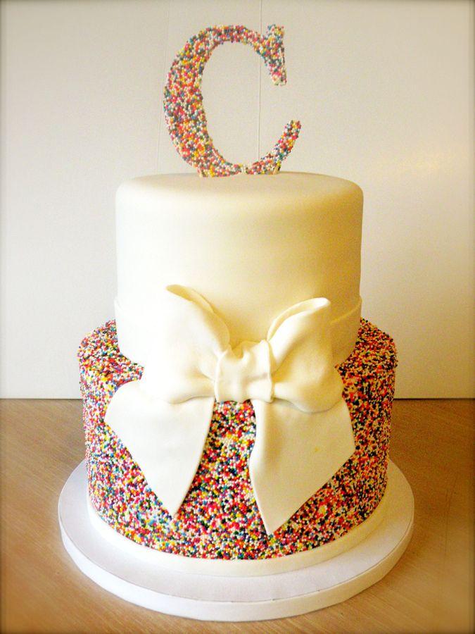 Rainbow wedding cake, sugar balls and big bow, different topper, more elegant perhaps.