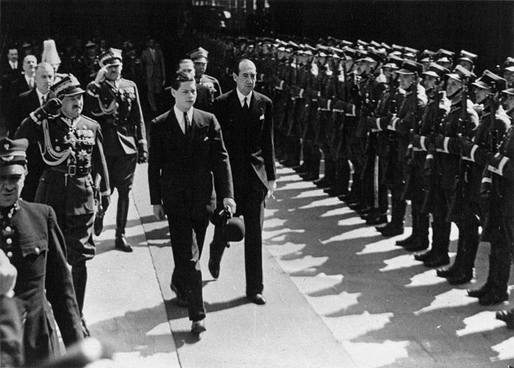 Crown Prince Michael of Romania (future King Michael of Romania) in Warsaw, following his visit in the United Kingdom for the coronation of King George VI. Jozef Beck , Foreign Affairs Minister of Poland also depicted. 1937.