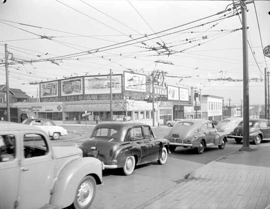 Corner Granville Street & West 4th Avenue looking North West  VPL Accession Number: 81320  Date: 1950  Photographer / Studio: Artray  Content: Corner Granville Street & West 4th Avenue looking NW, Stork Craft Ltd., 1511 West 4th Avenue, advertising billboards, overhead wires, automobiles