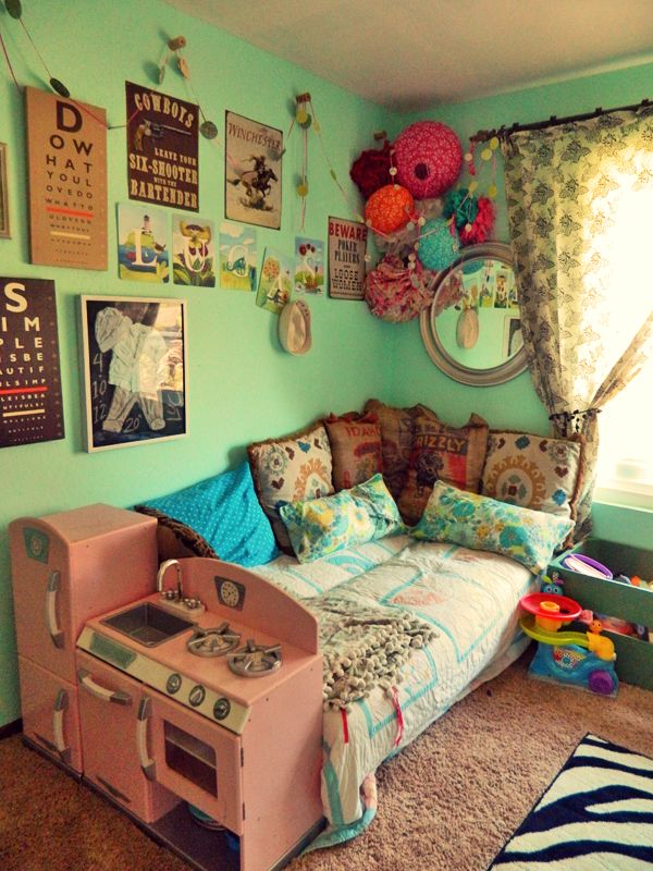More Pictures at the site: Cozy Reading Nook: Very important! Reading needs to be promoted in any way possible! So pile on the pillows and cozy quilts to make your babies want to stay and read the afternoon away.