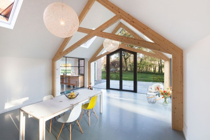 Farmhouse renovation by Bureau Fraai barn wood frames