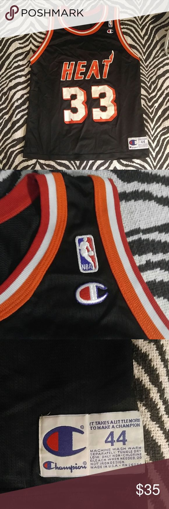 """Vintage Champion Alonzo Mourning Miami Heat jersey Amazing vintage 'Zo jersey made by Champion. Some light wear/cracking to logos as you can see in the pictures but overall in nice shape especially for an old school jersey. Size 40 which is generally considered a size L.  Length 28.5"""", Width 20"""" Champion Shirts"""