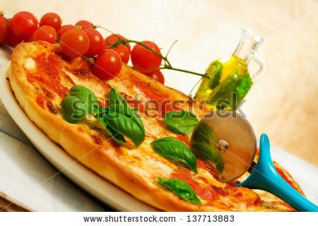 pizza margherita with basil by Donatella Tandelli, via Shutterstock