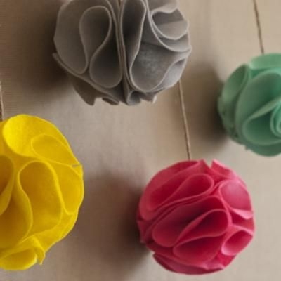 I like simple crafts that have big impact! Felt pompoms! Use for holiday or party decorations also!