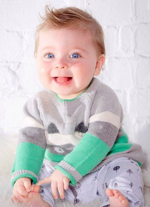 Bold colors, wide horizontal stripes, and a bear pattern on the front add distinctive style and cozy charm to the Bear Knit Sweater. Perfect for the little boy with a playful personality and a colorful sense of style, this long sleeve cotton/acrylic sweater features a crew neckline with contrast tipping, rib knit trim, two back buttons, and a rolled rim finish at each cuff. Share and repin! See more at deuxpardeux.com #kidsclothes #babyboy #sweater #kidswear #kidsfashion