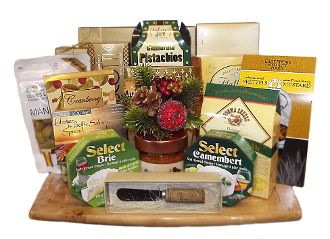 Gourmet Crackers, Cheese, Dips, Salsa and more presented on a wooden cutting board. Designed by Thoughtful Expressions Gift Baskets Canada in Fort St. John, BC.