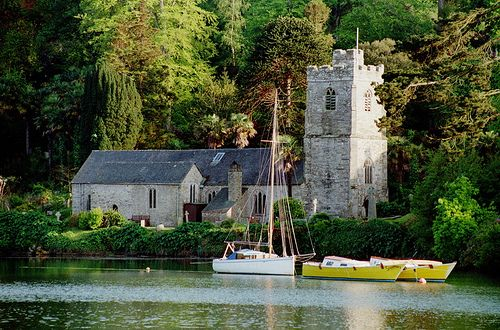 The church of St. Just in Roseland, Cornwall. This church sits next to a tidal creek off the Carrick Roads, and is surrounded by semi-tropical plants.